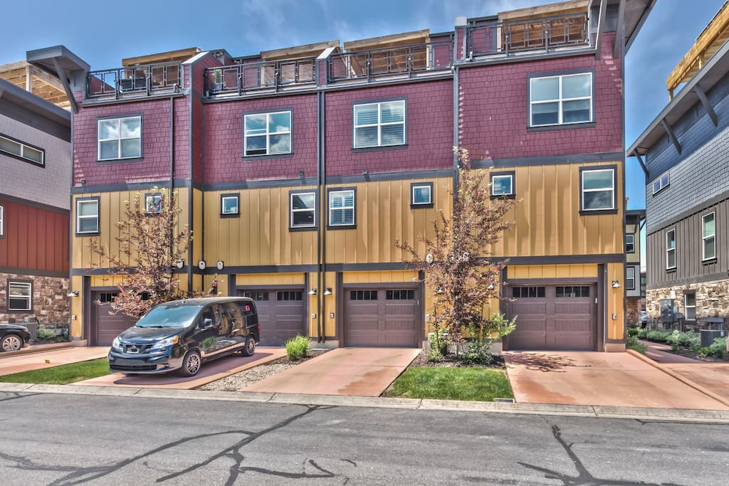 Rear View of Exterior with 1-Car Garage and Rooftop Deck with Amazing Views!
