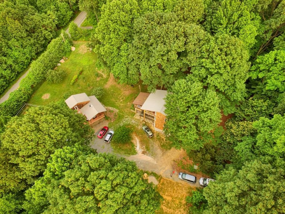 Aerial view of the property, the guest house is to the left and the main house is to the right.