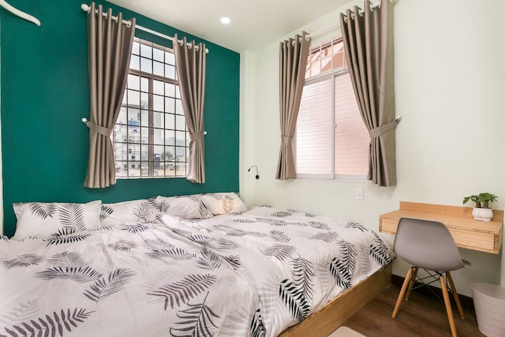 Master bedroom  - Large En-suite toilet - Two queen size bed for a spacious place to sleep which can occupied for 4 - 5 people.  - 2 large airy and safe window even for children stay - A desk for those on business trip