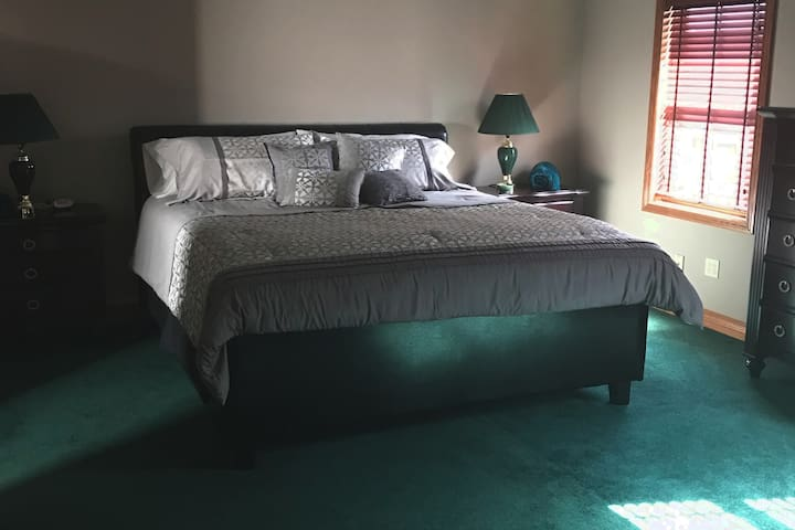 Snuggle up in a king sized bedroom and bed!