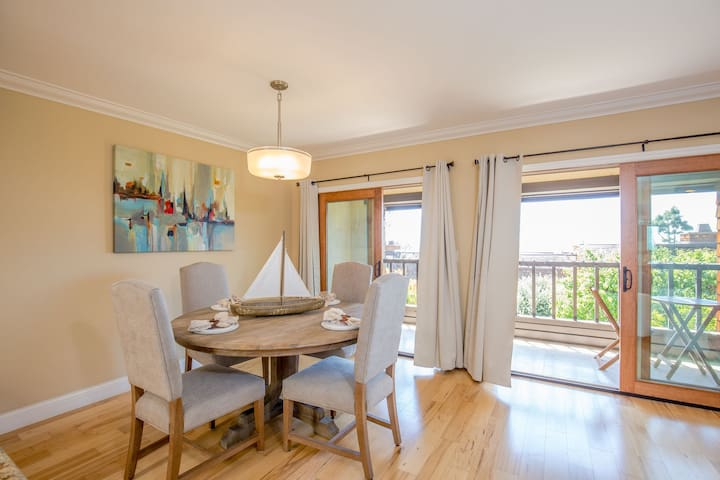 Dining area off kitchen perfect for entertaining with it's ocean view out the patio doors, patio with table and chairs to soak up the view