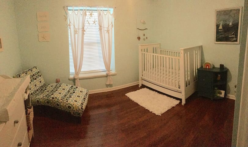 Crib and changing table. Queen air bed available for this room.