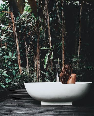 Meditations in the tub enveloped in the jungle... . . Bali life.