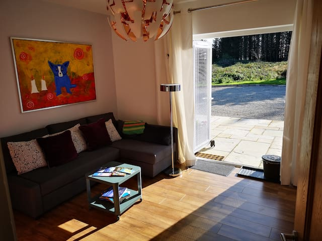 Small studio kitchen with patio doors leading out onto the private sun Patio and the wonderful nature. Perfect for the morning coffee or a barbecue. Multiple purpose room providing a comfortable double sofa bed. The studio ajoins the ensuite.