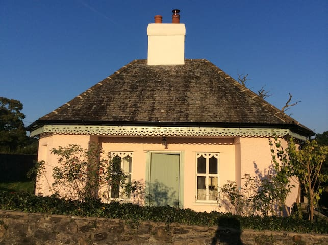 Tiny Pink Octagonal Cottage in the Towy Valley