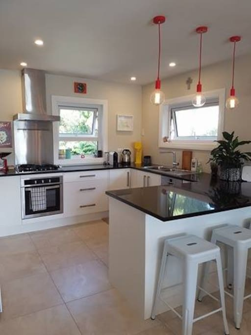 Kitchen with Nespresso coffee machine, gas hobs and all the extras