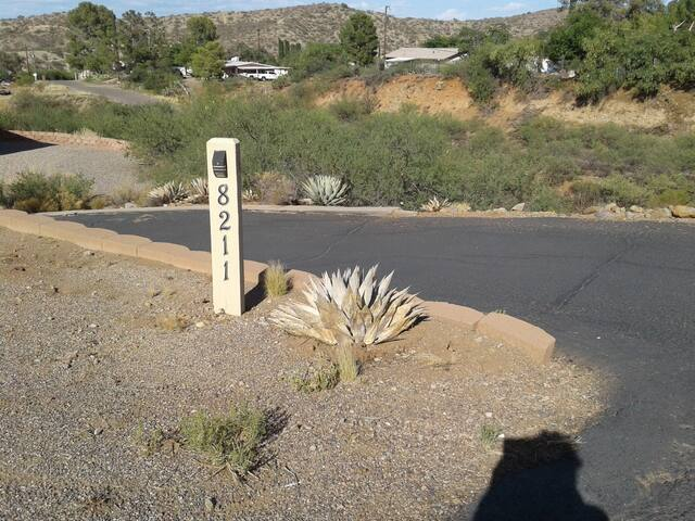 Address sign at the driveway entrance.