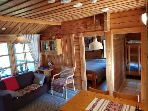 Cozy cabin & boat in Kerigolf holiday village.