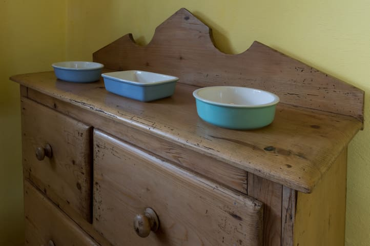 Mid-19th Century chest of drawers with individual casserole dishes ready for breakfast baking.