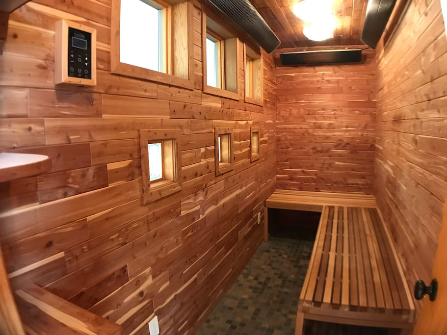 The ensuite cedar sauna and spacious two-person jacuzzi tub promise rejuvenating relaxation with your special someone.