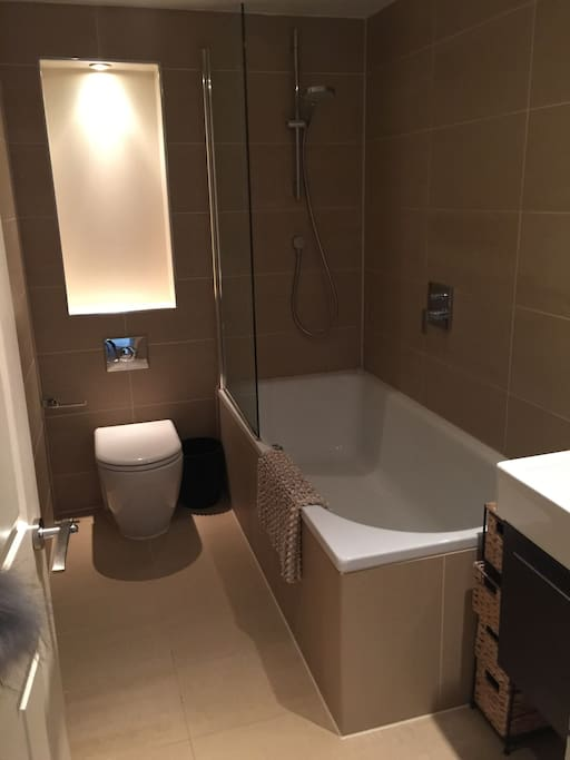 Newly refurbished bathroom with big bathtub