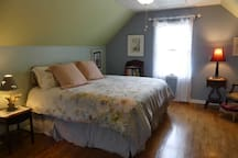 Private spacious upstairs bedroom with king bed, rocker, CD player, and electric fireplace