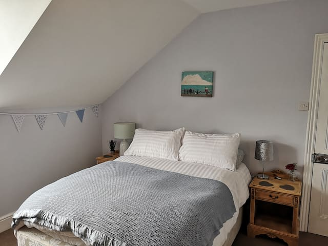 Spacious, light, double bedroom in family home.