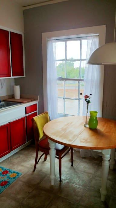 Lovely bright kitchen overlooking the park.