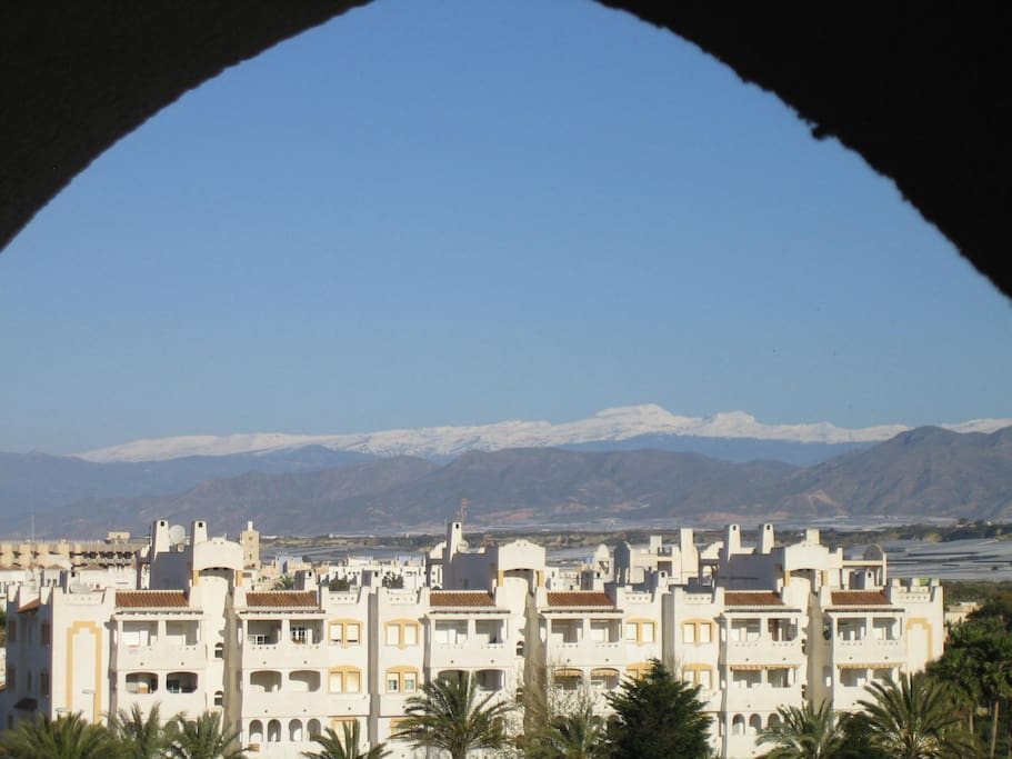 View of snow capped Sierra Nevada mountains from terrace
