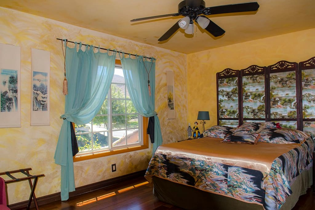 "Large'Vintage Shanghai""  Guest Room with best quality queen mattress & boxspring, ceiling fan, layered (includes 'block-out') window coverings and sliding screened windows looking north toward open hills."