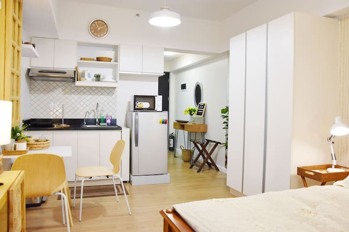 Well-equipped kitchenette with eating/working area.