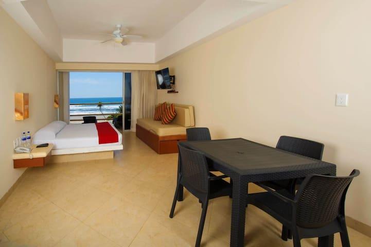Suite con refrigerador y vista al Mar