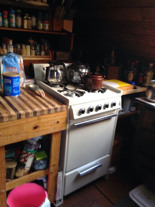 Upstairs Kitchen Stove under Sky Light. There are three kitchens. Three unit cabin