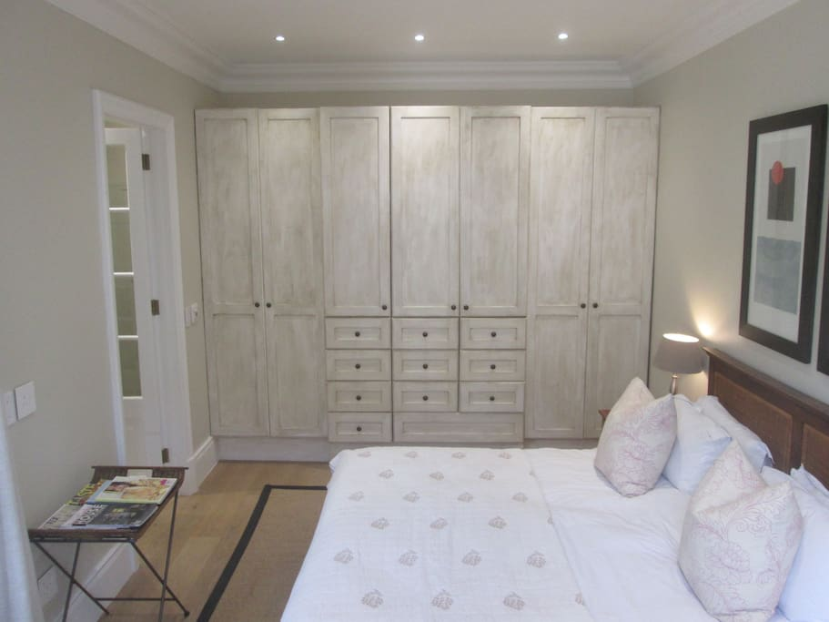 Spacious en-suite bedroom with French styled built in cupboards