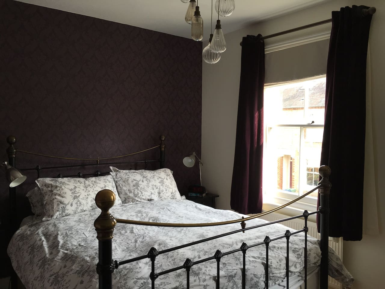 King size bedroom, Victorian iron bed.