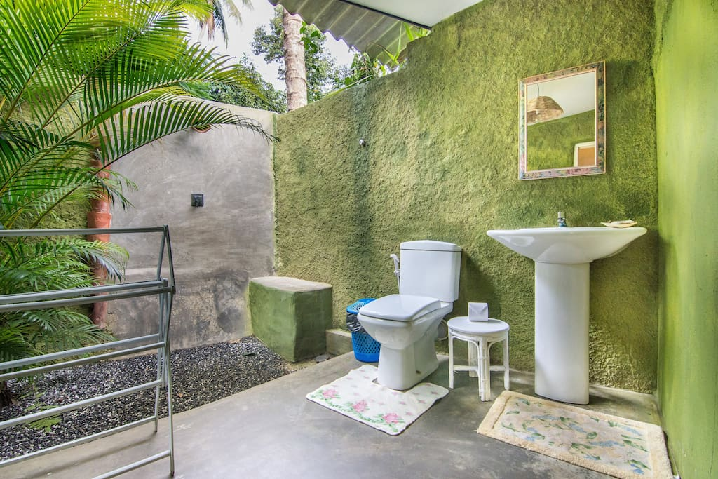 Open Air Concept En Suite Bathroom, with running hot and cold shower