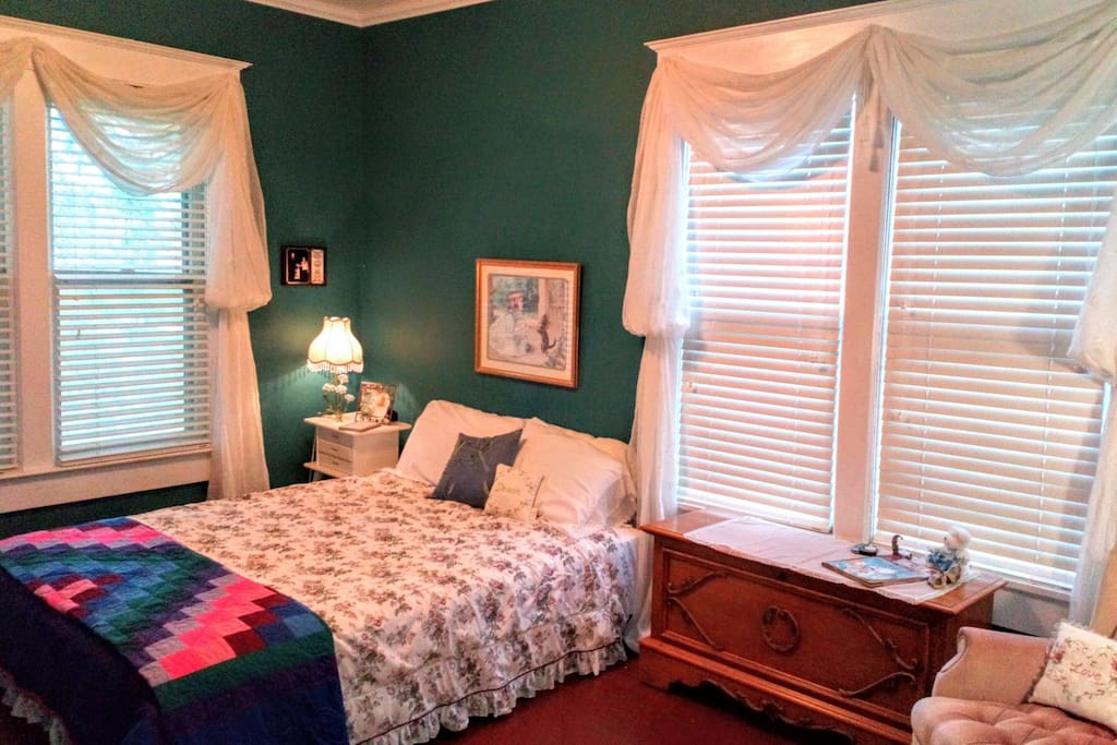 Large queen bedroom with closet, dresser, and work space.