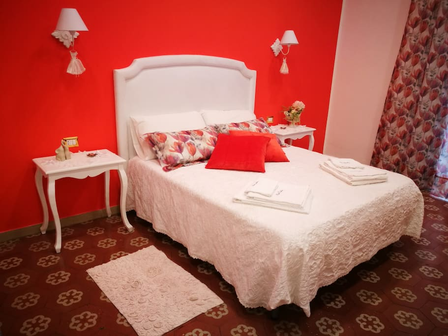 Camera con letto matrimoniale e letto singolo