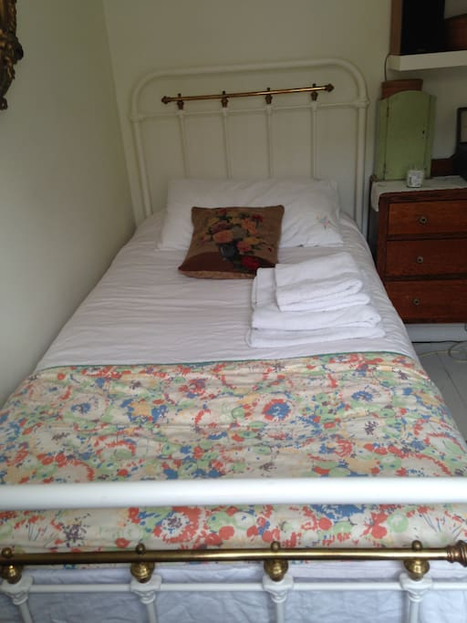 Victorian brass bed with new mattress.  Lots of towels.