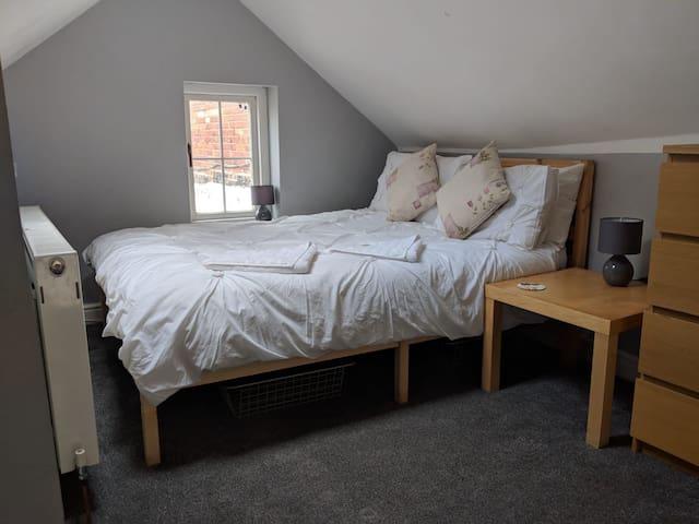 Cosy mezzanine bedroom area
