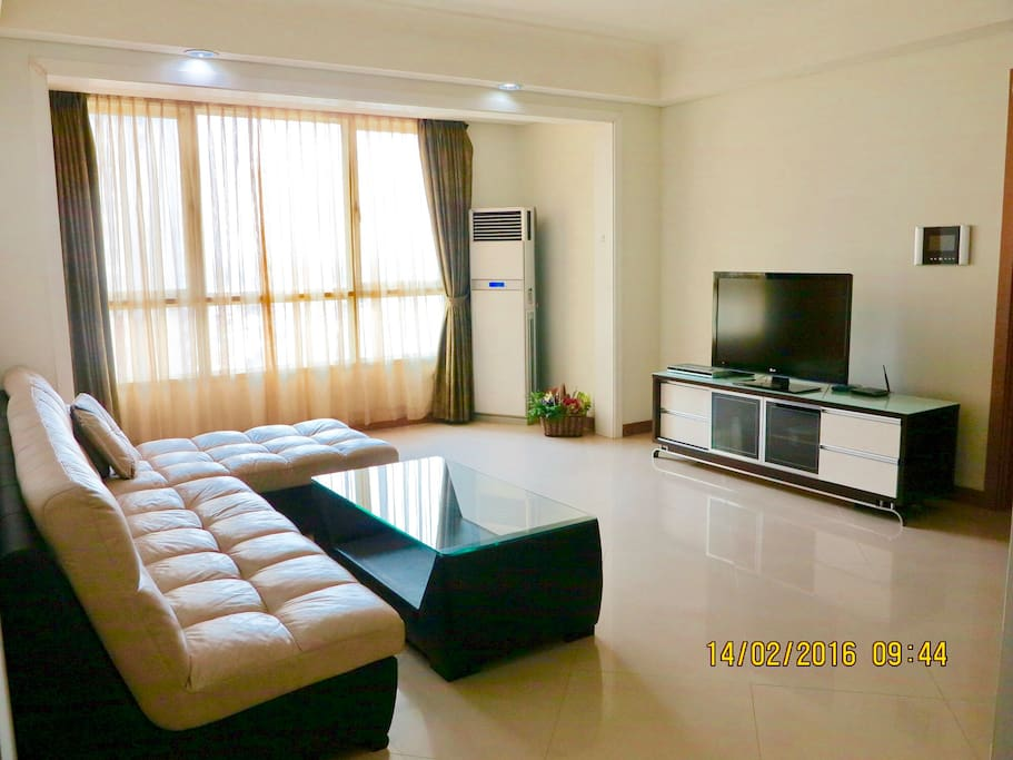 Living room with sofa and TV set