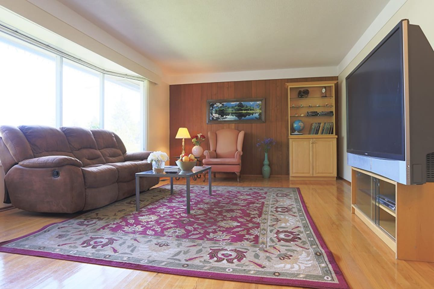 Spacious living room with large windows and 62 inch TV
