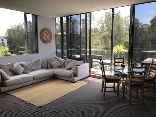 Modern sun lit apartment in a resort