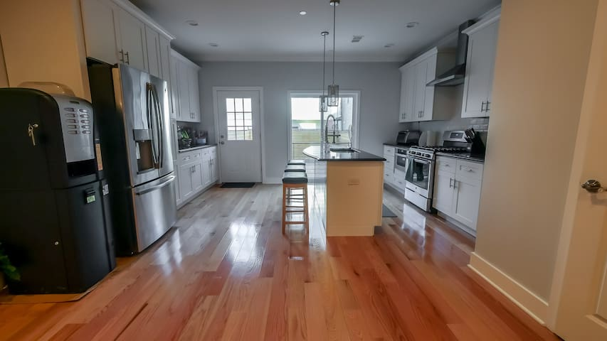 Big, modern kitchen filled with brand new appliances. Cook, eat, enjoy.