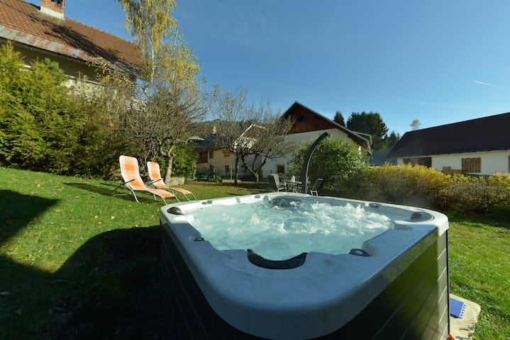 The garden with a BBq place, picnic area and a Jacuzzi you can use as much as you want.  Perfect for relaxing