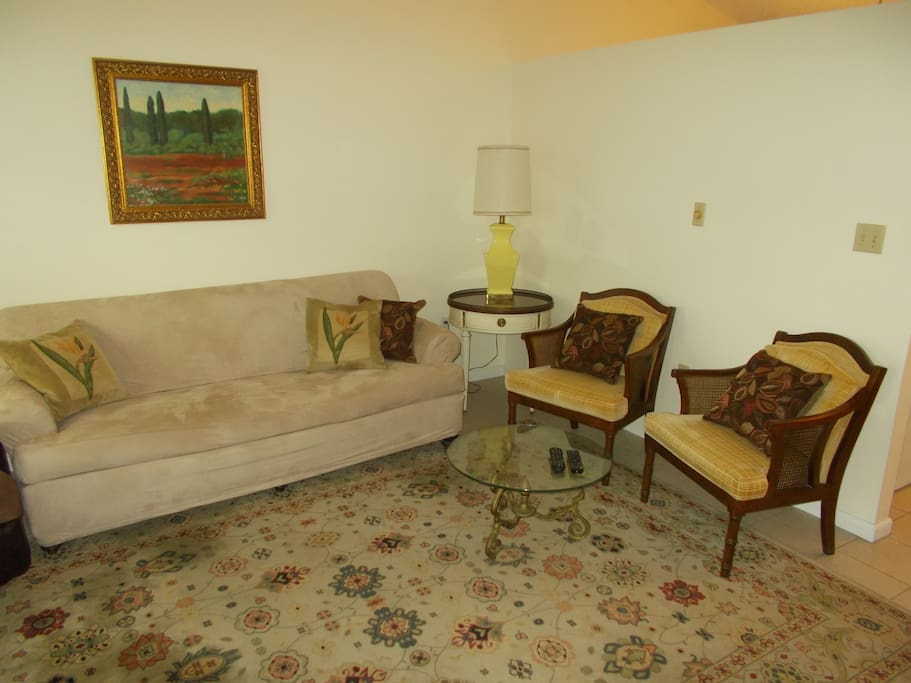 Sofa, Recliner, One of the wooden chairs, and an additional large armchair