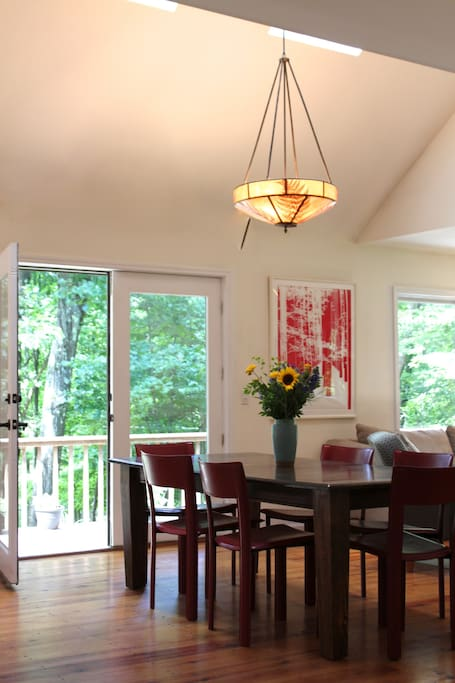 The dining living room has french doors opening onto the deck; there is  central air throughout the house