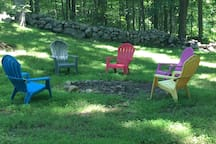 Outdoor seating around the campfire, shaded under the canopies of tall Oak, Shag-Bark Hickory and Maple Trees in complete serenity...