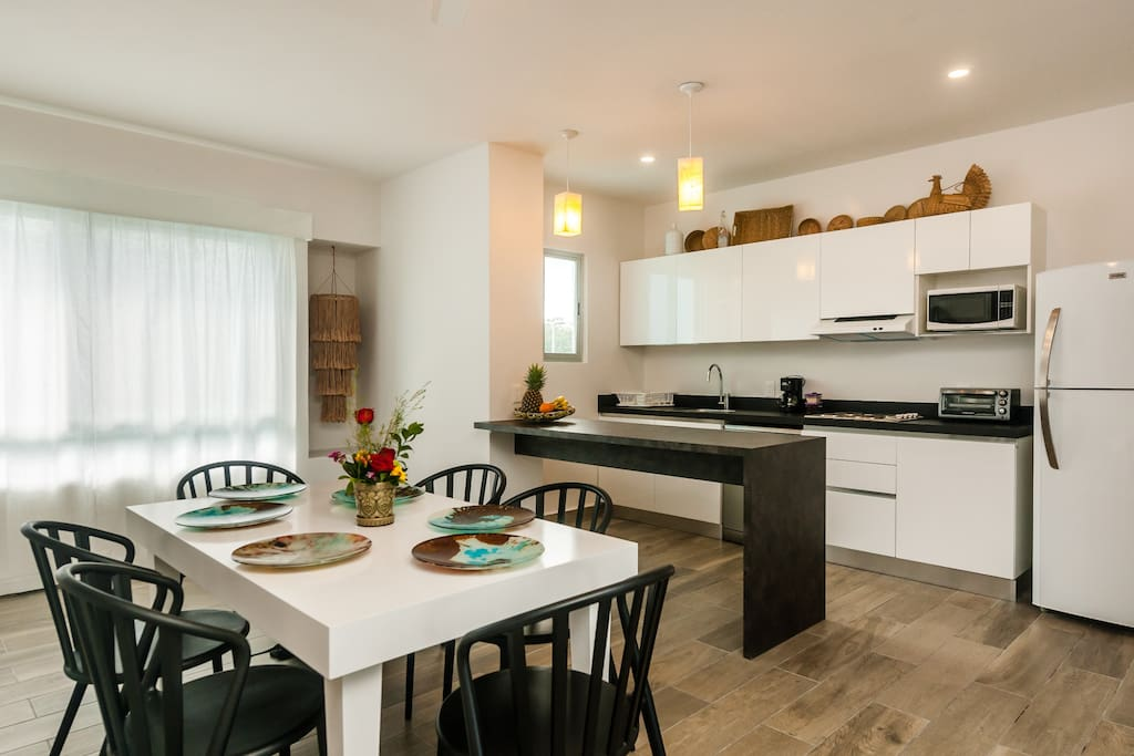 Dinning area and a fully equipped kitchen