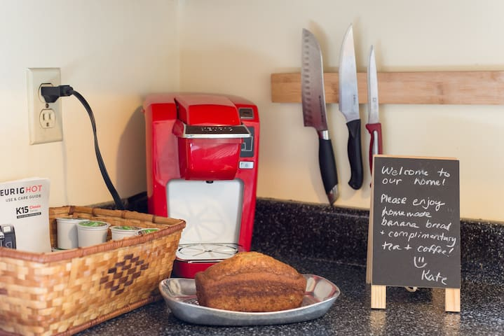 Host provides homemade banana bread, k-cups, and tea for each guest.