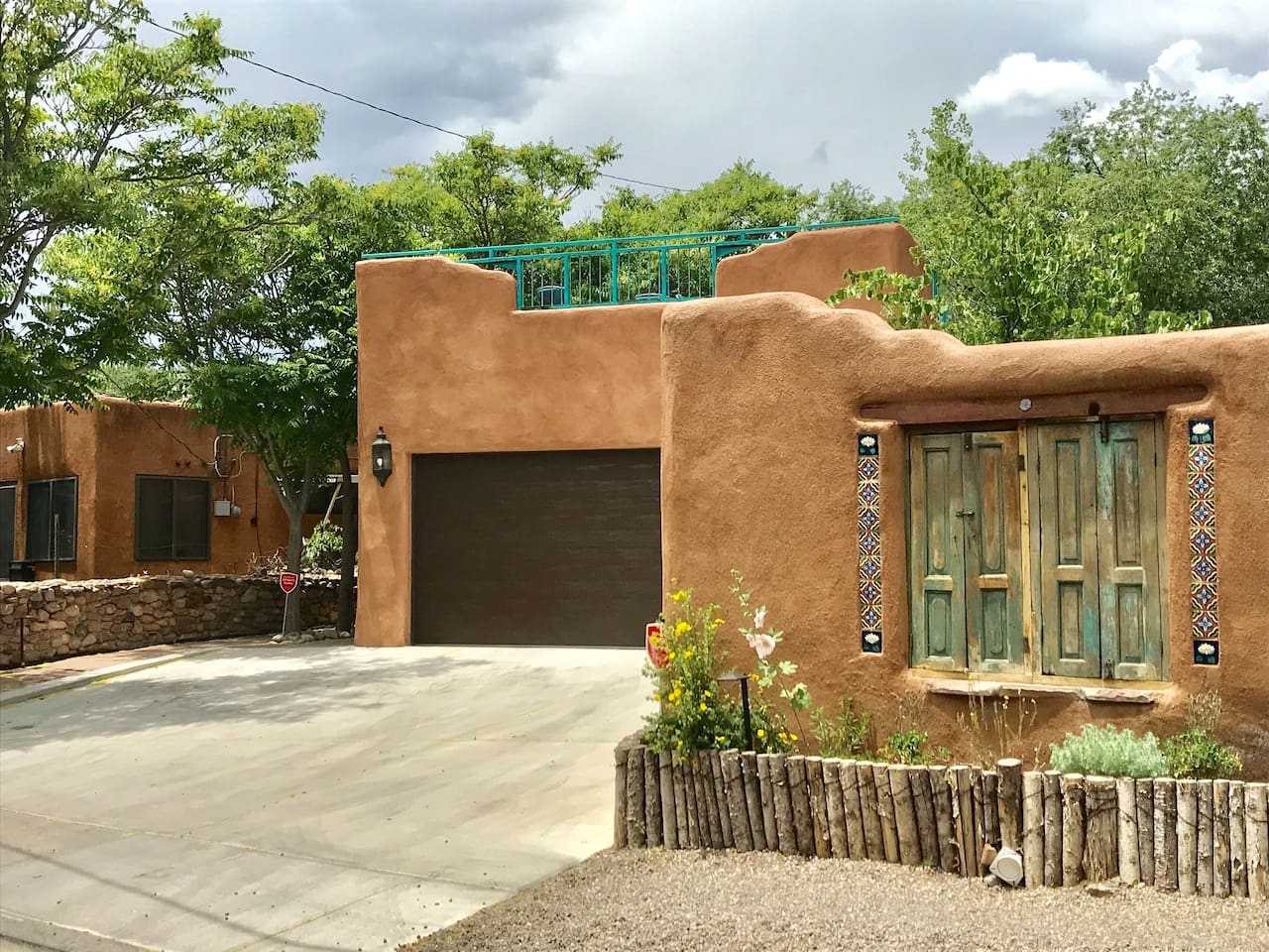 The garage accommodates two vehicles and three in the driveway. The beautiful ventilla can be opened to view the street while sitting around fire pit. The deck is lover the garage and overlooks the arroyo.
