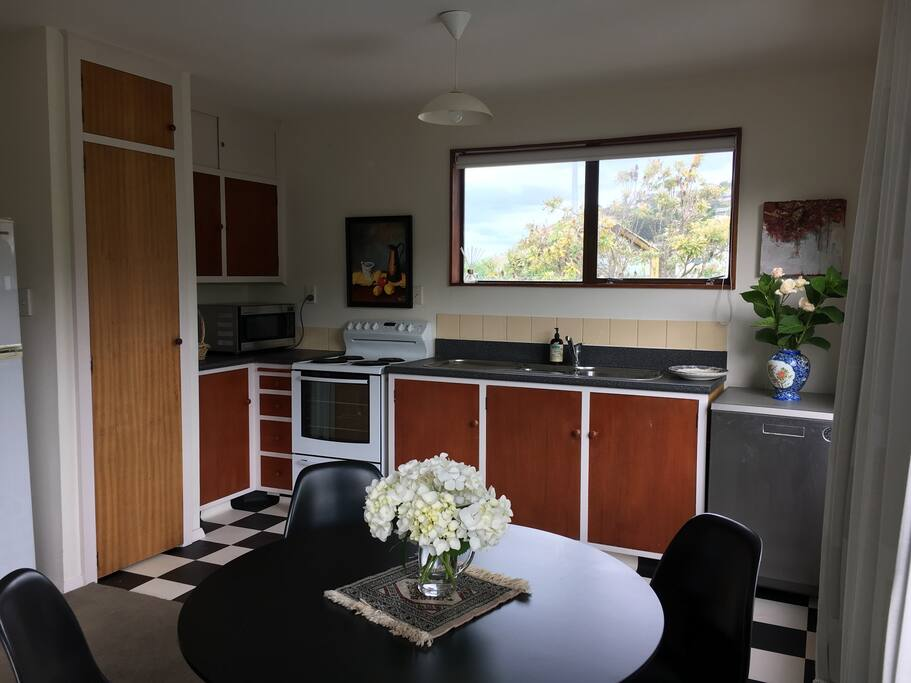 Kitchen looking over road to Moncks Bay and beach