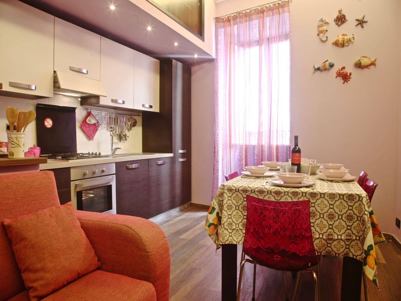 Living Room/Fully Equipped Kitchen • Salotto/ Cucina Completa