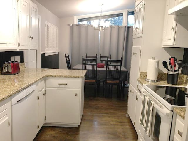 The home has a full kitchen, utensils, a spice rack and pots and pans.