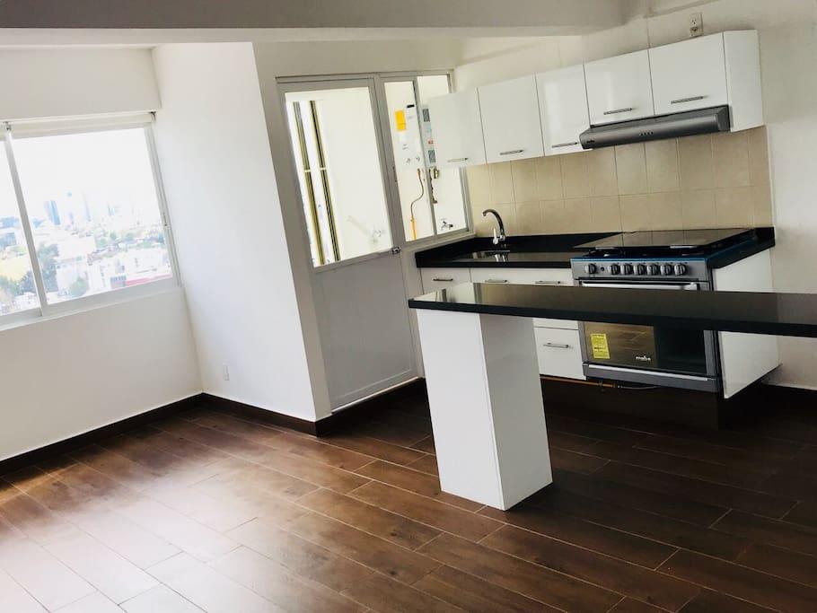 kitchen Equipment with fridge, micro, stove, coffee machine