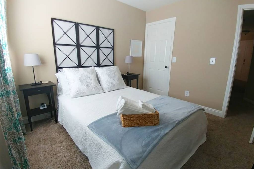 Relaxing queen bedroom, spacious walk-in in closet with shelves and hangers