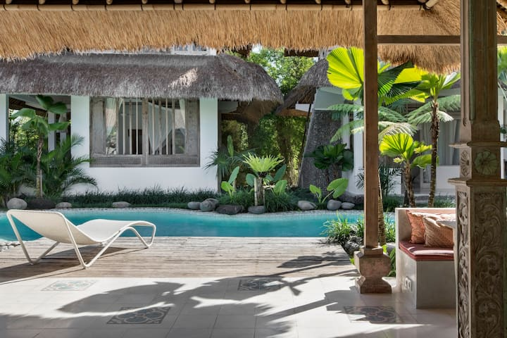 View to our natural pool and our very cool lounge chairs.