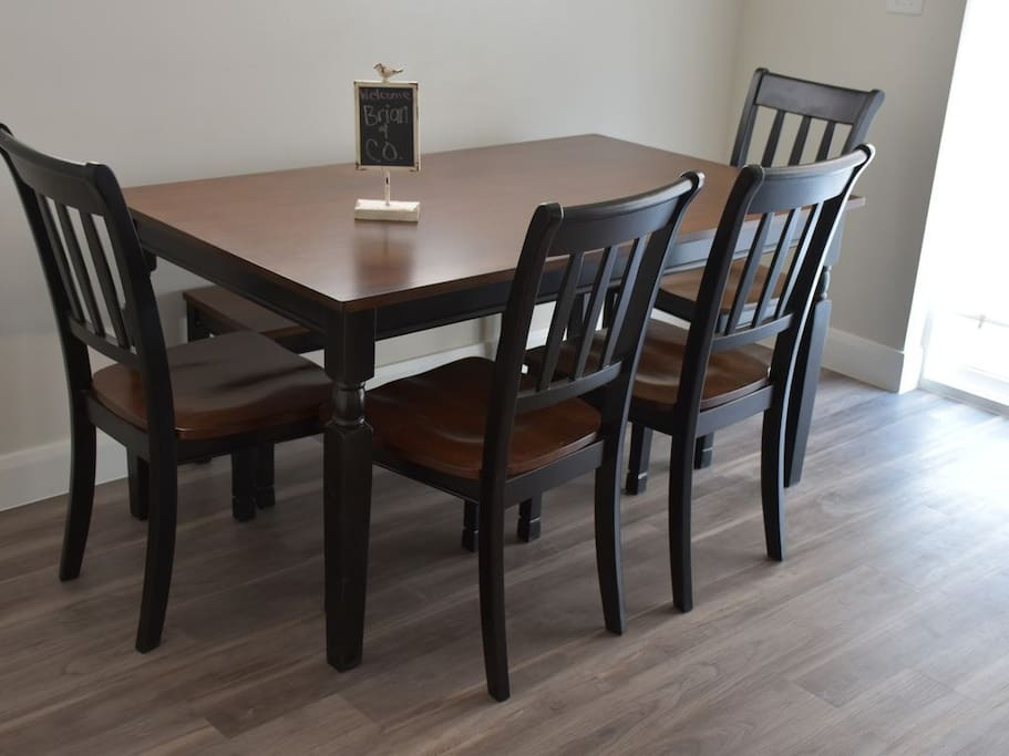 The kitchen table sits six, with four on chairs and two on a bench