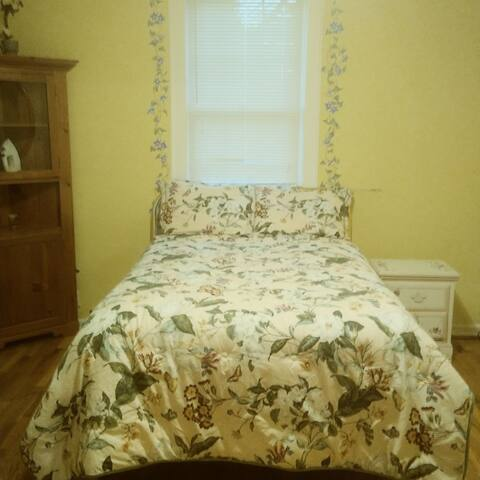 Large bedroom with washer and dryer and plenty of room for a queen air mattress (available by request)