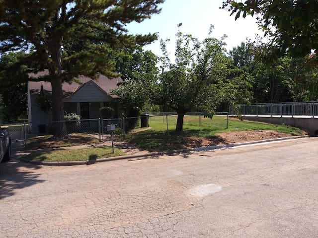 Front of house with Holliday Creek Trail in the background.